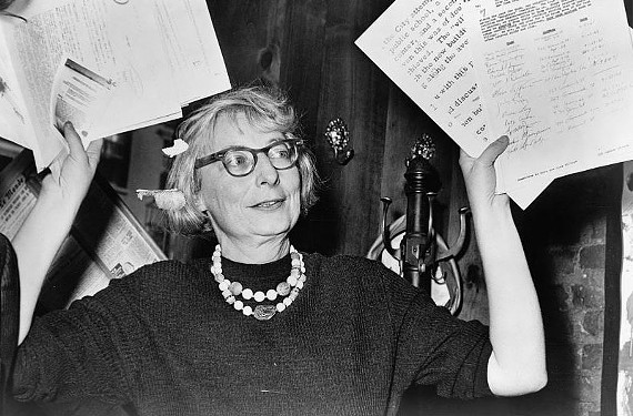 Jane Jacobs, then chairwoman of the Committee to Save the West Village, holds up documentary evidence at a press conference on December 31, 1960 at the Lions Head Restaurant at Hudson and Charles Streets in New York City. Jacobs was instumental in efforts to keep multiple blocks of Greenwich Village from being demolished in the 1950s and 1960s.