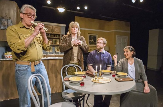"House guest Frank (Daniel Moore) disrupts supper plans for partners Joyce (Melissa Johnston Price) and Phyllis (Sara Heifetz) and their son Jared (Chandler Hubbard) with an improvised Seder dinner in the Annie Baker comedy, ""Body Awareness."""