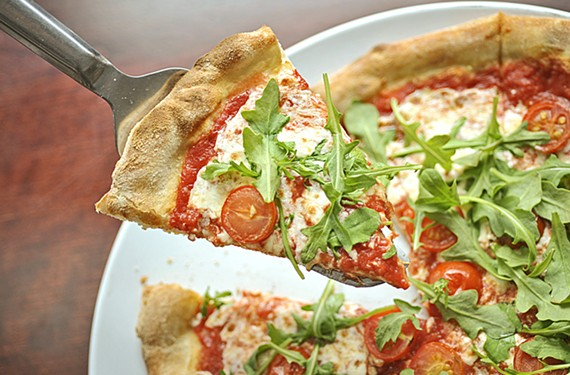 A great crust is the foundation of a good pie, and at Shockoe Valley Pizza you also get a plethora of ingredients. Here, the First Love pie is loaded with mozzarella, cherry tomatoes, arugula and shaved Parmigiano-Reggiano.