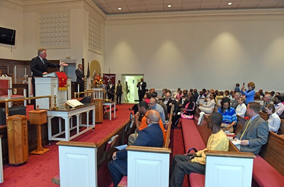 Gov. Terry McAuliffe speaks to state officials, felons and activists gathered at a town hall last week at 31st Street Baptist Church. He discussed the hurdles to civil rights before his executive order restored the ability of 206,000 felons in Virginia to vote.
