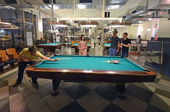 Socializing can take the form of friendly competition at Greenleaf's Pool Room, which is attached to the Hotel John Marshall, at 100 N. Sixth at Franklin Street.
