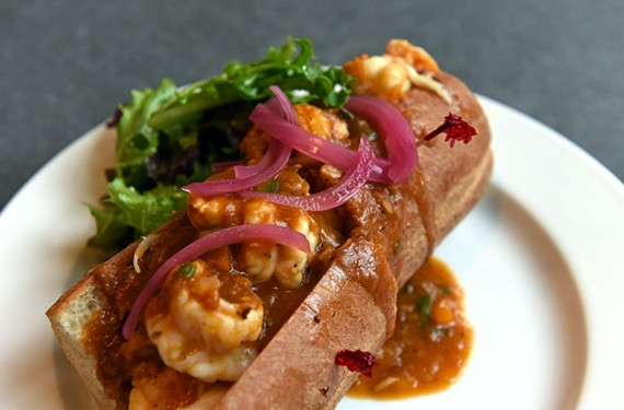 The barbecued shrimp po' boy is lavished with creole gravy and piled high with a spicy cabbage and sun-dried tomato salad topping.