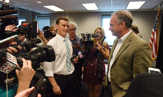 After a roundtable discussion about the Zika virus on July 5, Sen. Tim Kaine greets reporters at the Virginia Department of Health in Richmond.