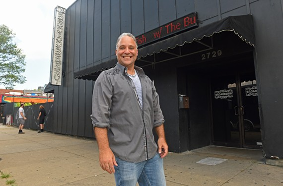 B.J. Kocen, co-owner of Glave-Kocen Gallery, stands in front of the Broadberry where he will be holding the CD release party for his double album.