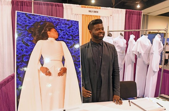 """Former """"Project Runway"""" contestant Anthony Williams offers his line of burial gowns at last week's funeral directors conference in Richmond."""