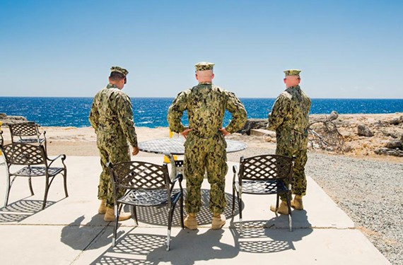 "Debi Cornwall, ""Smoke Break, Camp America,"" from the series Gitmo at Home, Gitmo at Play, 2014, at Candela Gallery"