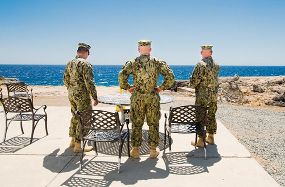 "Debi Cornwall's ""Smoke Break, Camp America"" is from the series Gitmo at Home, Gitmo at Play, which explores the grim absurdities of life for prisoners and guards at Guantanamo Bay, Cuba."