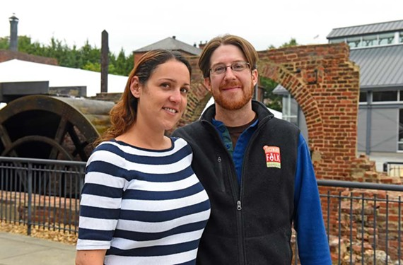 Folk Fest volunteers Laura Napky and her fiance, Grant Osborne, stand at Tredegar Iron Works near the space where they'll be married on Friday evening.
