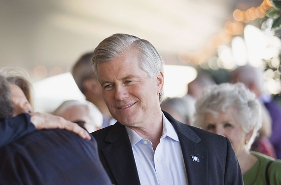 Former Virginia Gov. Bob McDonnell, smiles as he and his wife, Maureen, are greeted by friends and supporters during a victory party in Virginia Beach. Supporters were celebrating the Supreme Court unanimously overturning Bob McDonnell's conviction.