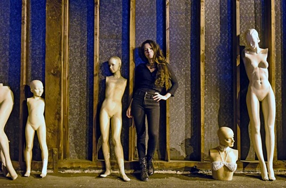 Eva Rocha, a native of Brazil, with some of her mannequins inside her spacious Maury Street studio.