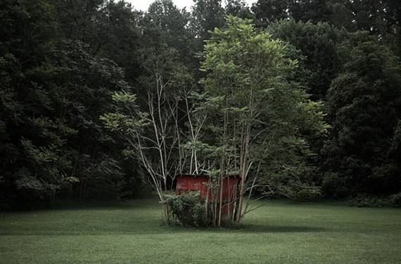 "Works by photographer Paige Critcher from her ""Hinterland"" include deeply observed images of rural isolation such as ""Trapped Shed."" Critcher spent a brief period of time learning from famous Virginia photographer Sally Mann."