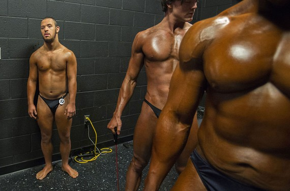 Jon Atkins, 19, left, stands with other competitors at the American Theatre in Hampton before taking the stage during The Body Sculpting Open Championships.