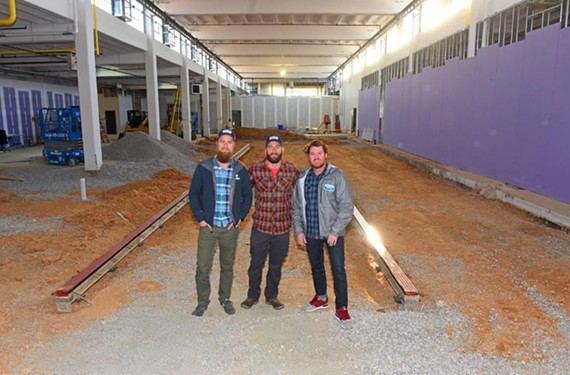 Founders Joey Darragh, his cousin Tony Giordano and marketing and environmental director Nathan Winters stand in the vast space that will be Väsen Brewing Co. this summer.