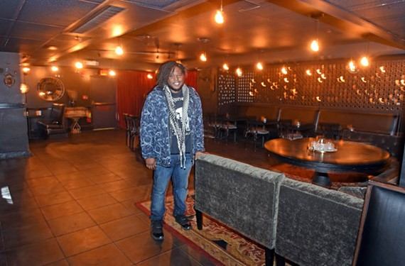 Well-known musician Reggie Pace stands in the intimate performance space beneath Vagabond restaurant, next to the National. Pace is bringing a musician-friendly approach to booking the late-night spot.