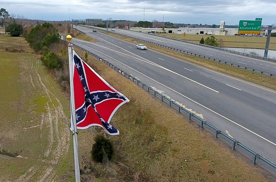 An 8-foot by 8-foot Confederate Battle flag flies along the Chesapeake Expressway on land leased from Stephen Etzell's wife and brother-in-law by The Virginia Flaggers.