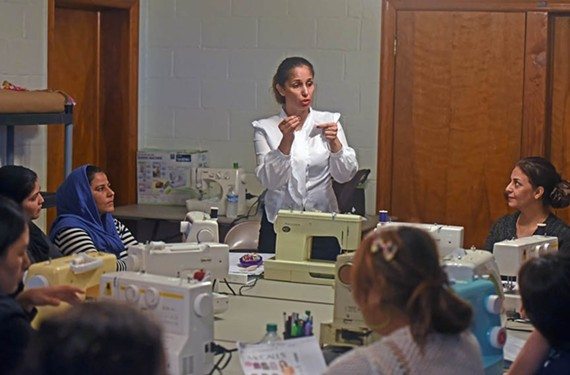 Teaching a sewing class in Scott's Addition, an Iraqi refugee in Richmond says she understands the concern about vetting of people from countries with radical political and religious groups.