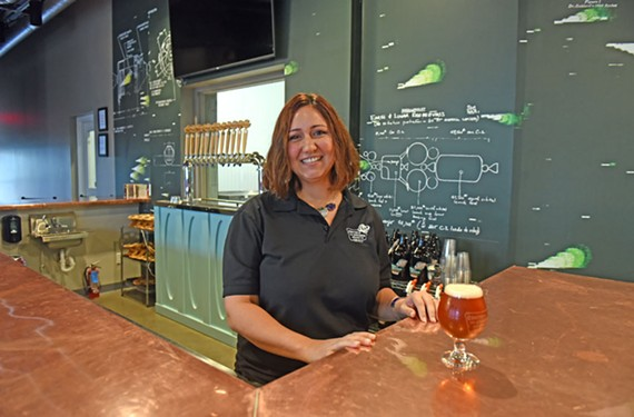 Ashley Ray of Center of the Universe Brewing Co. stays behind the scenes, helping to drive the company forward.