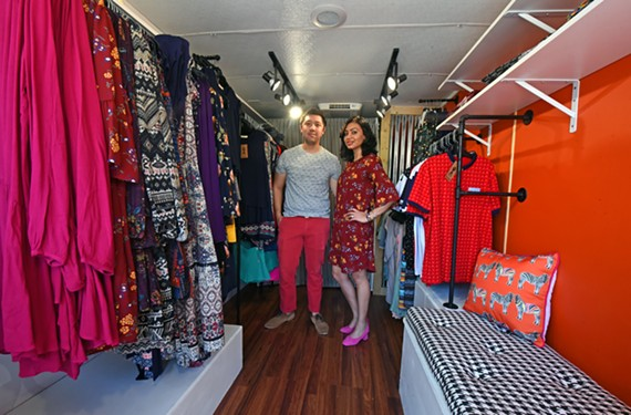 Chris Suarez and his wife, Harneet Kalra, stand inside the Textures Trend Co. trailer, which was painted by local artist Mickael Broth.