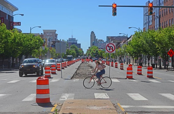 A cyclist crosses Broad Street at Shafer in front of ongoing bus-line construction. Richmond's bike infrastructure is supposed to double this year, if neighborhoods don't fight the changes.