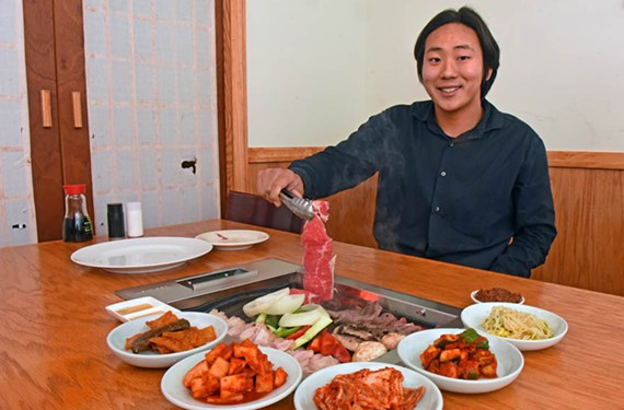 Jiwon Hyun demonstrates how to cook Korean barbecue at San Su in South Side.