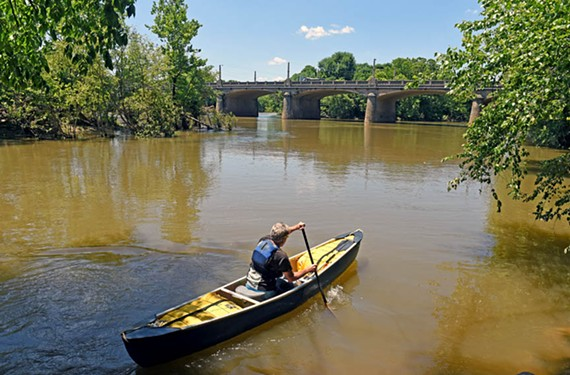 Mike Elsea puts his canoe in the James River at the Shockoe Basin, near a combined-sewer overflow. Elsea has been canoeing the James River for 40 years.