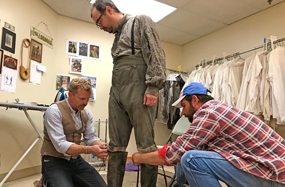 "Brad Watson, left, and Ed Brogan fit extra Ricardo Padilla for a costume on the set of the AMC drama ""Turn"" which returns for its final season on Saturday, June 17, at 9 p.m. for a two-hour premiere."