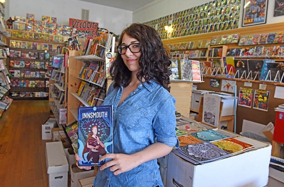 "Local artist Megan James holds her H.P. Lovecraft-inspired comic book, ""Innsmouth,"" at Velocity Comics. Her work was featured this year alongside other gay creators for Pride Alley at Awesome Con in Washington."