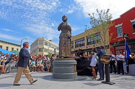 A festive crowd of about 600 people gathered all day for the unveiling of the Maggie Walker statue, the first Richmond woman to be honored among the city's outdoor monuments. Her great-granddaughter, Liza Mickens, stands to the right beside Mayor Levar Stoney, with sculptor Antonio Tobias Mendez to the left of statue.