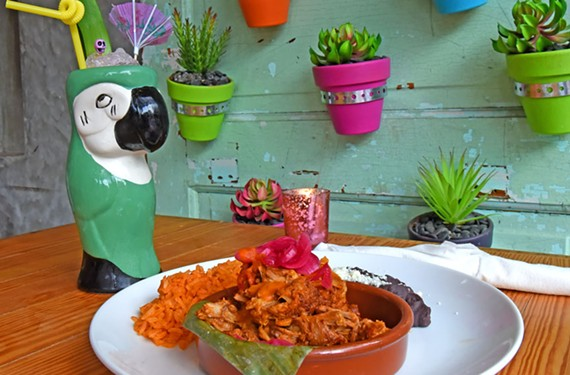 Cochonita pibil — pork shoulder that's been marinated and then roasted in banana leaves — is combined with black beans, rice and habanero salsa, making for a perfect mix of spicy and earthy flavors.