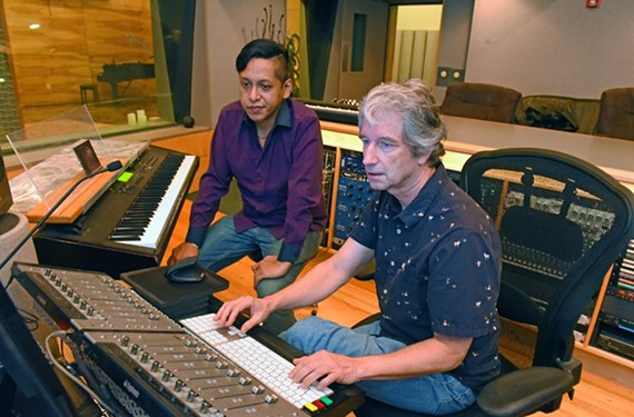 Albert Yapur sits next to longtime local producer and session musician Carlos Chafin, at In Your Ear studios in Shockoe Bottom.
