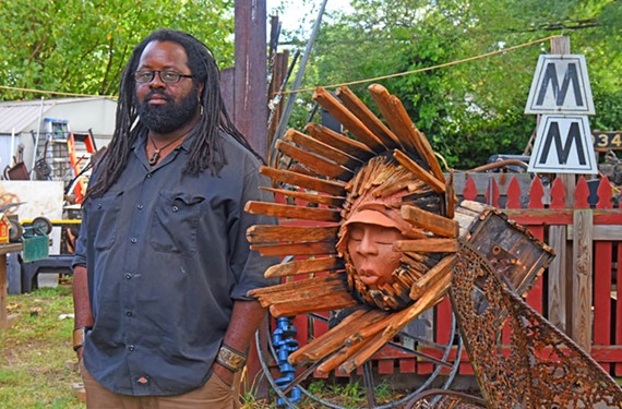 "Artist Keith Ramsey stands next to his work ""Sunflower,"" a collaboration with Carren McAdoo Clarke. Ramsey will be at the RVA MakerFest at the Science Museum of Virginia next month."