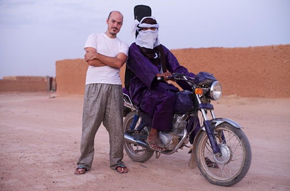 "Guerrilla ethno-musicologist Christopher Kirkley and guitarist Mdou Moctar remade ""Purple Rain"" in Niger's desert. They're showing the film and performing for free at University of Richmond."