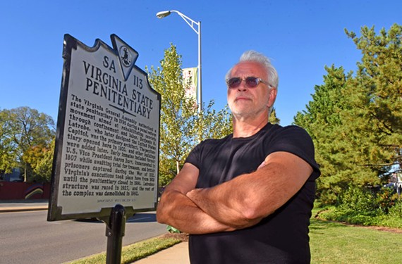Author Dale Brumfield, field director for the nonprofit advocacy group Virginians for Alternatives to the Death Penalty, stands by a historical highway marker by the former site of the state penitentiary at Spring and Belvidere streets.
