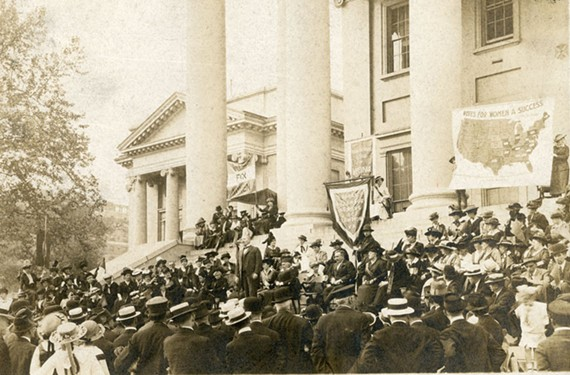 Women convene at the State Capitol for a suffrage rally in 1916.