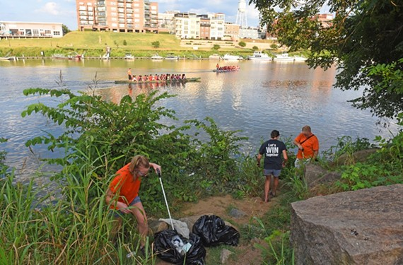 At Ancarrow's Landing in July 2017, volunteers with RVA Clean Sweep fill 50-gallon trash bags with litter thrown into or left beside the James River.