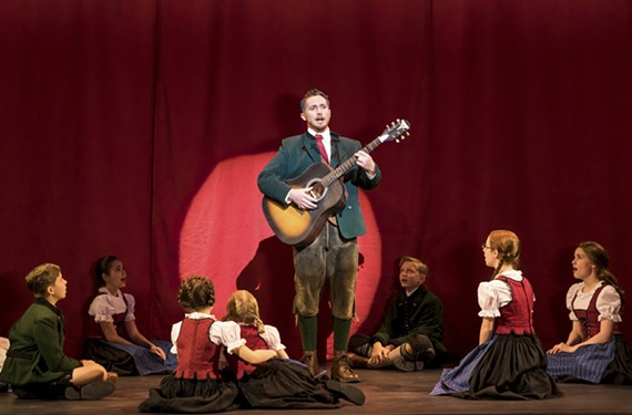 "Actor Mike McLean as Capt. von Trapp during a performance of the Rodgers and Hammerstein show tune, ""Edelweiss."""