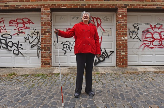 Local author Judith Vito stands near Grace Street, where she has lived for years since leaving behind her carnival days.