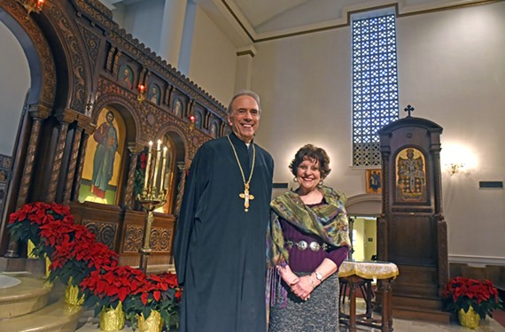 The Rev. Nicholas Bacalis of Sts. Constantine and Helen and Sylvia Evans, church member and curator, stand in the cathedral sanctuary.