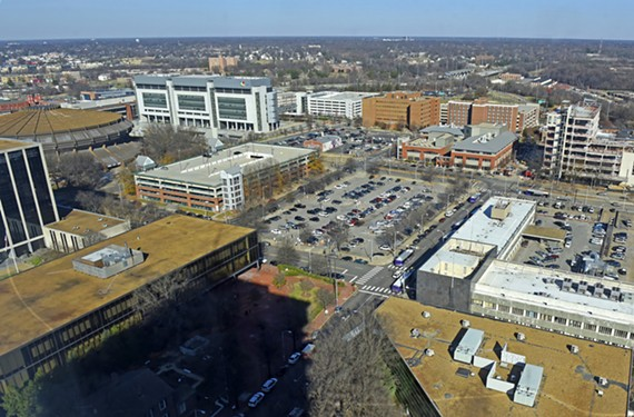 The Coliseum, at left, and the L-shaped Public Safety Building, at right, should be demolished and the street grid should be restored north of Broad Street.