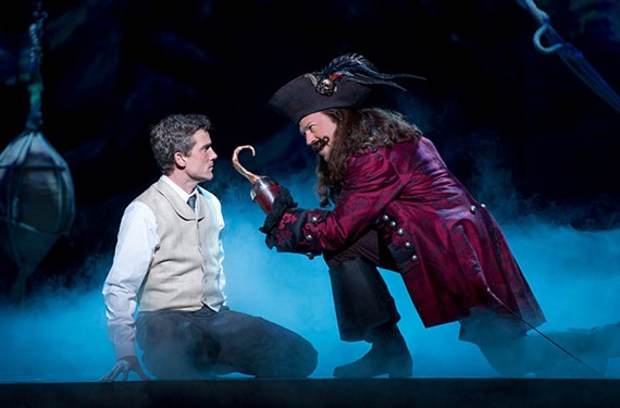 "Kevin Kern plays J.M. Barrie and Tom Hewitt is Captain Hook in the Broadway touring production of popular musical ""Finding Neverland."""