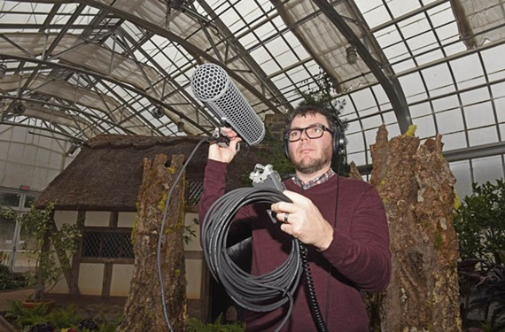 Vaughn Garland shows off some highly sensitive recording equipment inside the conservatory at Lewis Ginter Botanical Garden. Garland is helping produce a Sound Arts Richmond program this spring.