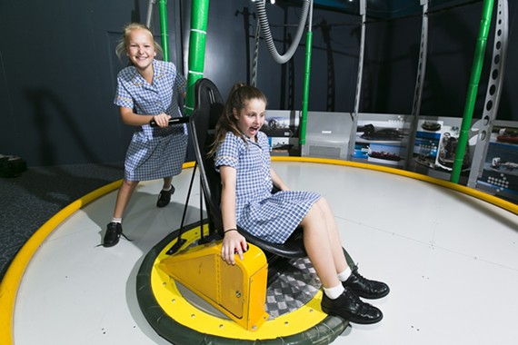 Some kids try out the hoverdisk as part of the Going Places exhibit opening this week at the Science Museum of Virginia.
