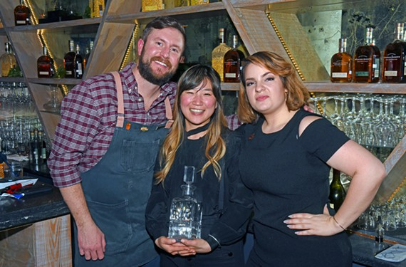 Justin Ayotte of Saison won third, Sophia Kim of Saison won first and Lauren Unterberg of Brenner Pass won second in the Woodford Reserve Manhattan Experience regional bartender competition.