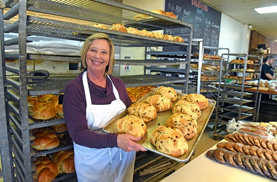 Montana Gold Bread Co. owner Sher Lahvic displays a pan of freshly-baked Irish soda bread.