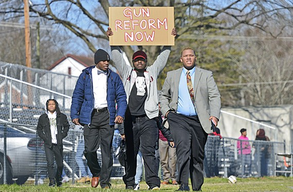 Thomas Jefferson High School students Kaurice Boyd, Darrius Kenny and Ta'Quan Grant walk out of class in support of gun reform and school safety.