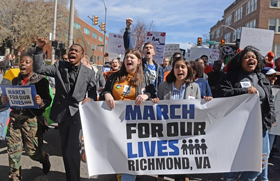 Students marching through the city to the Capitol on Saturday, March 24.