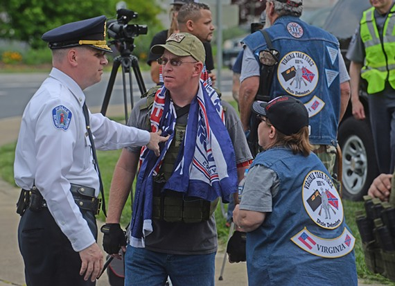 Deputy Chief Steve Drew of the RPD holds back Thomas Crompton of the New Confederate States of America, which again held a small rally on Monument Avenue met by many more counter protesters.