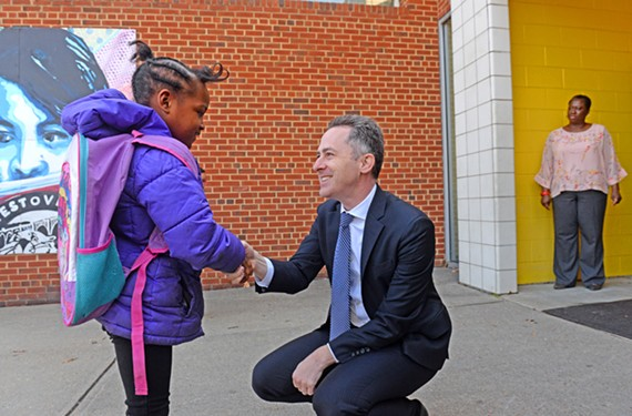 Richmond Public School Superintendent Jason Kamras greets a student at Westover Hills Elementary School on March 28.