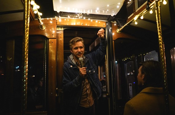 The Hop On, Stand Up Tour from RVA on Wheels places local comedians at the head of a festive trolley taking you around the city to drink beer, then work it off by laughing. Jonathan Nelson is the host and co-founder.