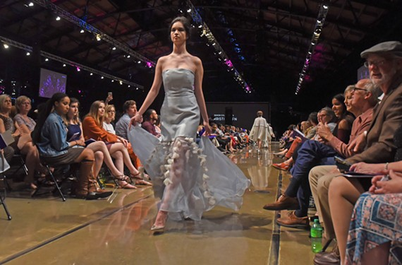 Senior Yujin Chen earned the honor of best execution by the jury of judges at VCUArts' 2018 Fashion Show. Model Hannah Duff wears a strapless gown with floral details.